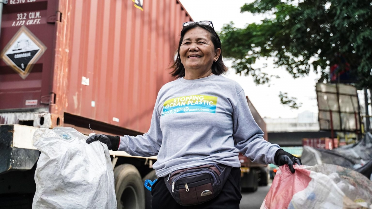 Person carrying plastic to recycle