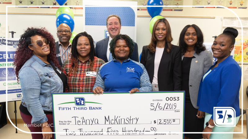 FTB employees standing with a scholarship winner