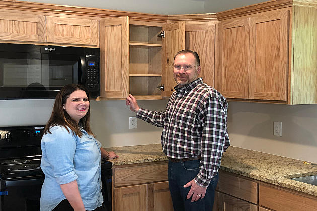 2 people standing in their new home