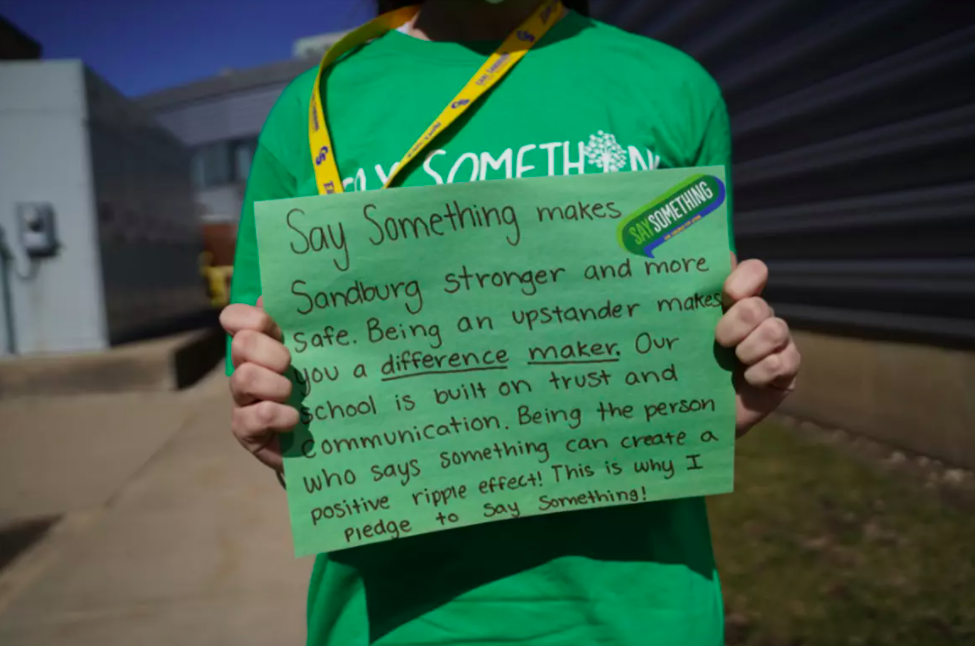 """A student in Illinois holds up a sign for Sandy Hook Promise's National """"Say Something"""" campaign. Credit: SANDY HOOK PROMISE"""