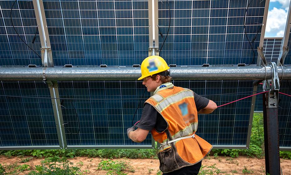 Duke energy employee works on Solar panels