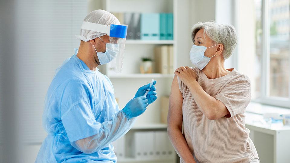 Doctor giving patient vaccine