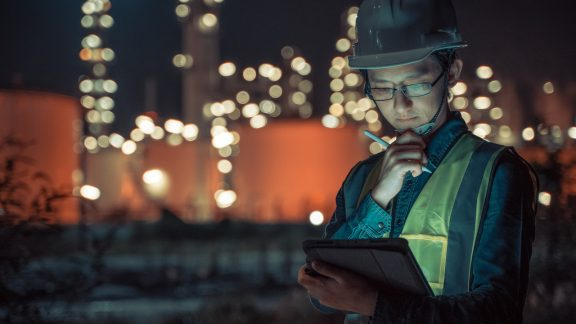 Construction worker using a tablet.