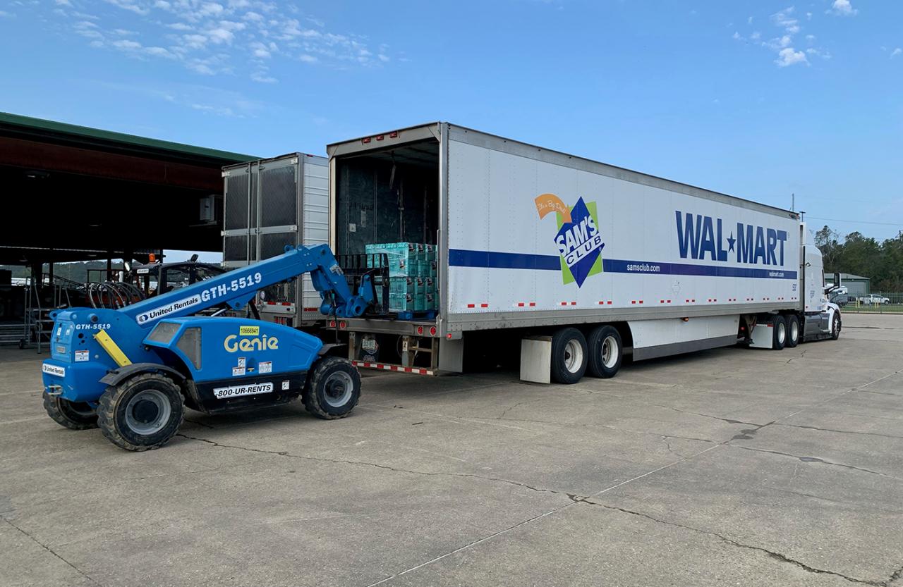 Genie fork lift loading a Walmart Tractor Trailer