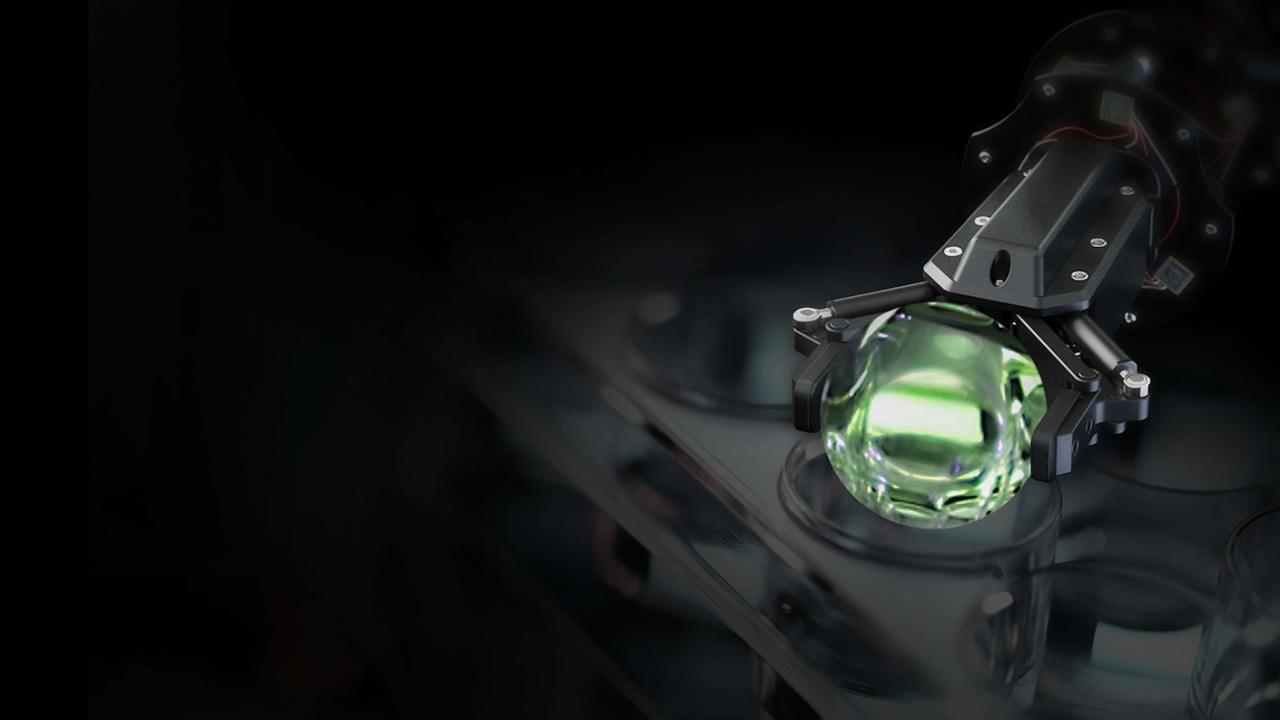 robot arm mining a green crystal