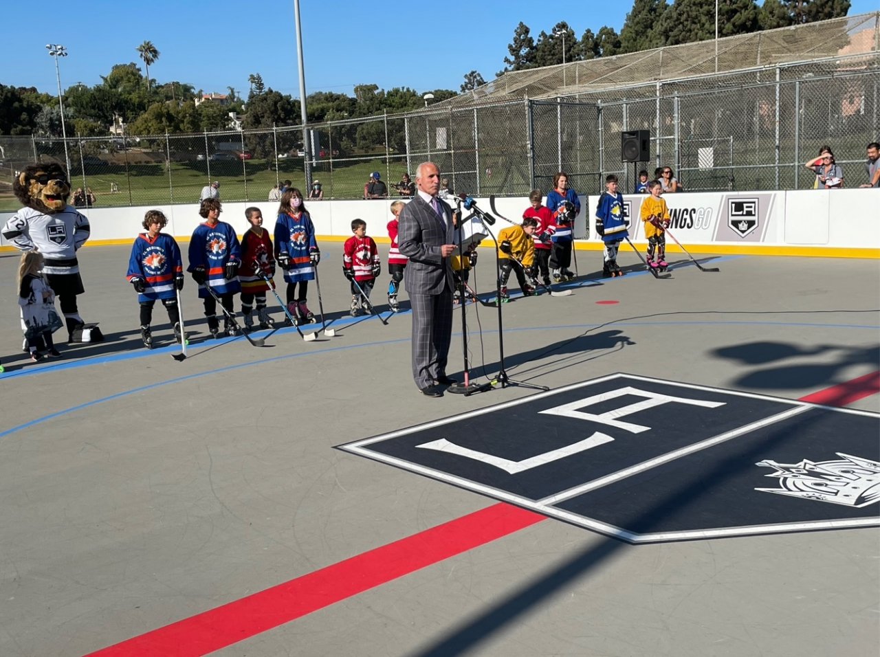LA Kings radio analyst Daryl Evans emcees the ribbon cutting ceremony to commemorate the newly completed roller hockey rink in El Segundo on August 26, 2021.