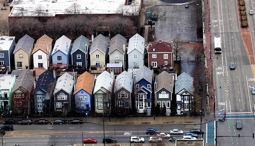 Birds eye view of colorful row houses on a busy street