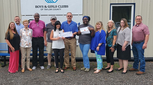 Foley Cellulose, presenting a check for $9,000 to the Boys and Girls Club of North Central Florida.