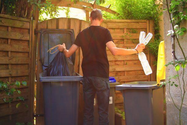 Man throwing away trash