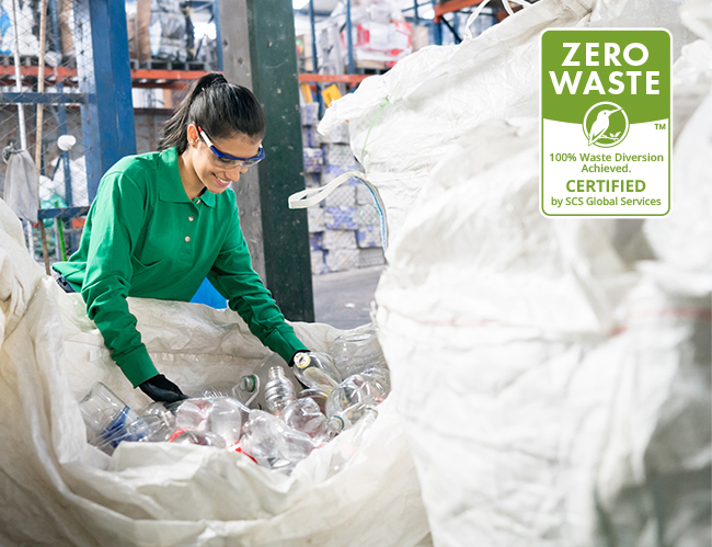 Worker recycles bottles