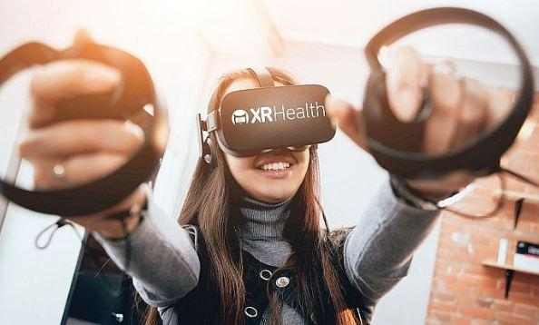 Person using VR headset and controllers