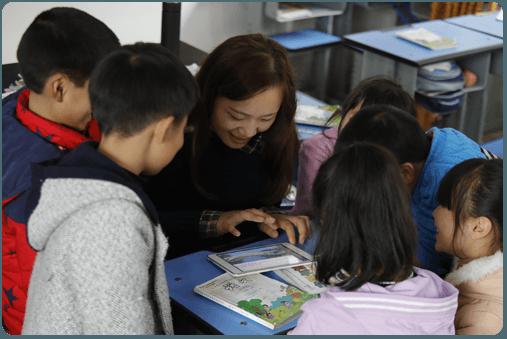 Teacher reading to student