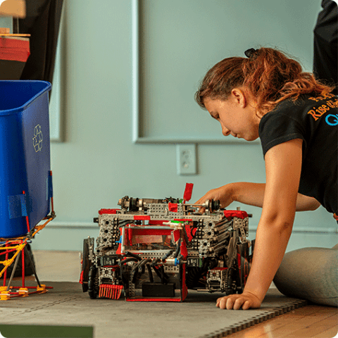 A student working on a robot project