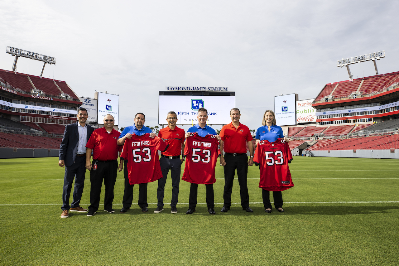 Fifth Third Bank and Tampa Bay Bucs leadership came together on the field to celebrate the new community partnership.