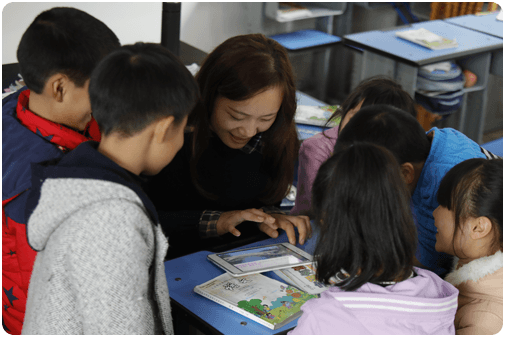 children learning with a teacher