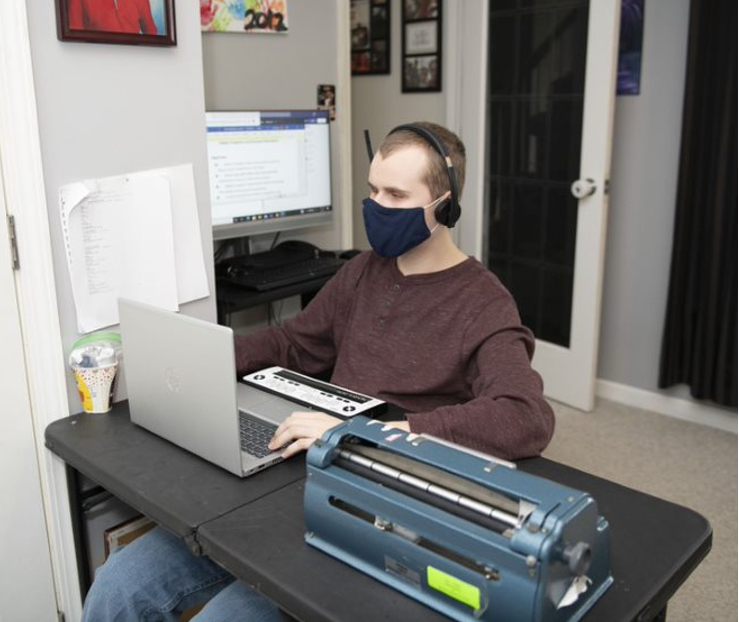 (In the photo above, Dylan uses his donated HP laptop, external monitor, and headset to do his lessons from home. He also has a school-issued Braille display and Brailler to use.)