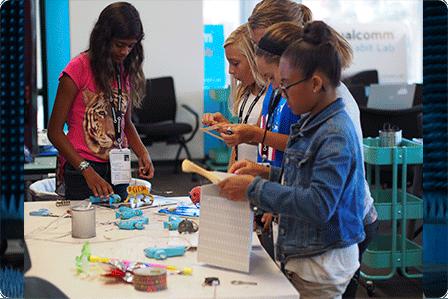 girls assembling a project at a tech camp