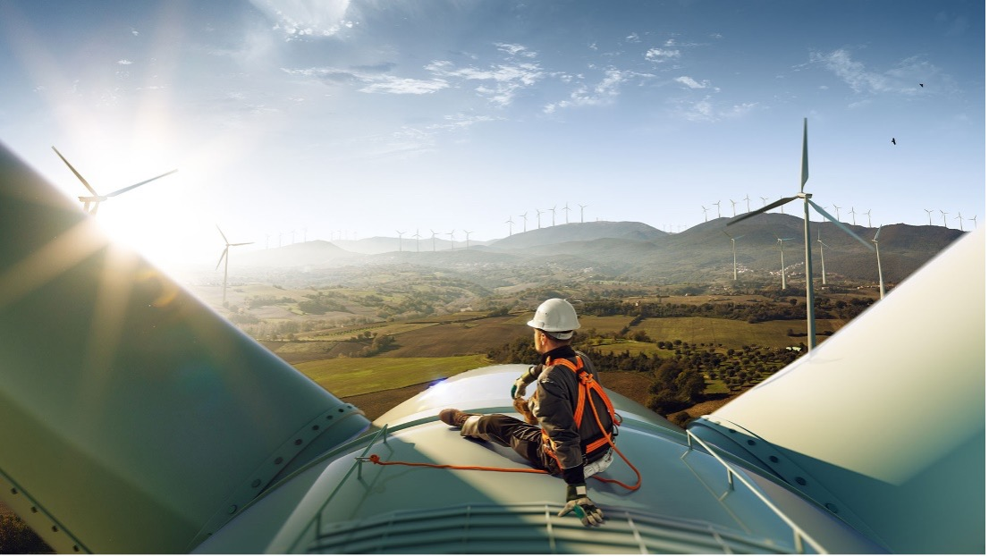 worker sitting on windmill