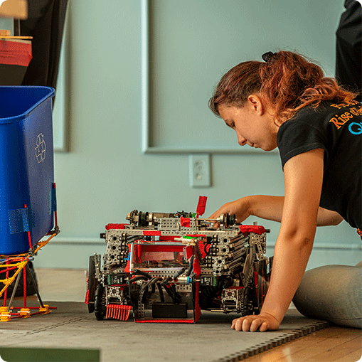 person working on a robot