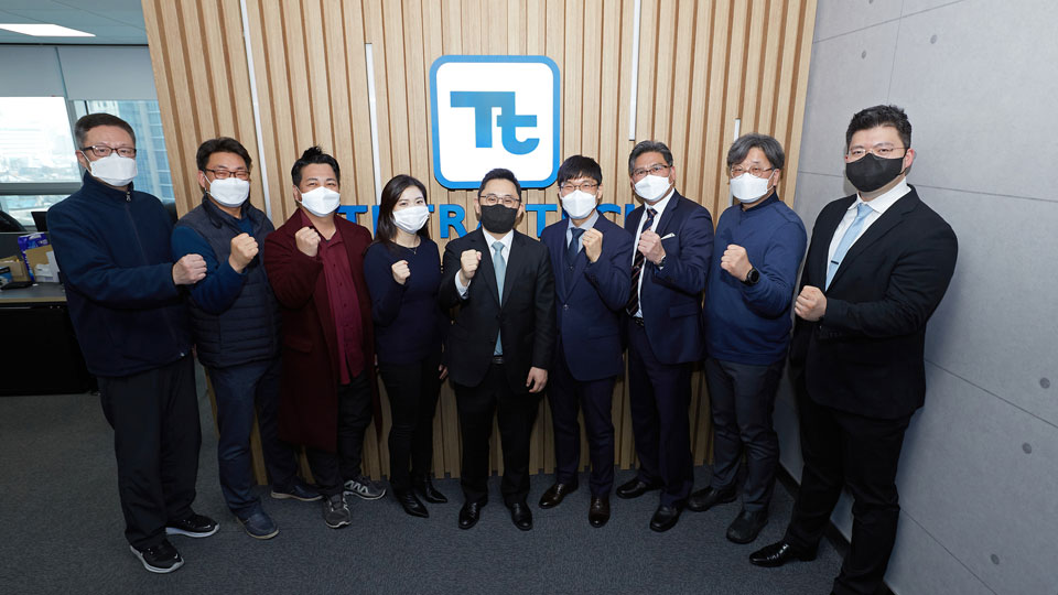 9 Tetra tech employees standing together with fists out