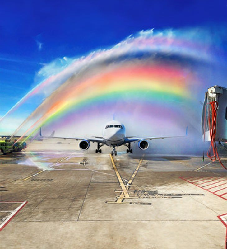 Plane taking off under a rainbow of color