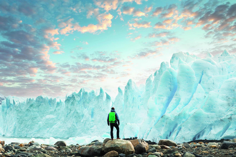 hiker looking at an iceberg