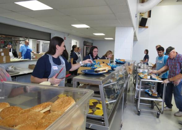 Valley Bank employees prepare and serve meals at Eva's Community Kitchen.