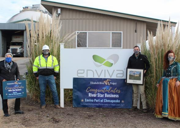 """Enviva accepts the """"Sustained Distinguished Performance River Star Business"""" Award from The Elizabeth River Project. From left to right: Pam Boatwright (Deputy Director Administration & River Star Businesses Program Manager), Aaron Leftwich (Enviva Terminal Manager), Aaron Anseeuw (Enviva Port Manager), Princess Elizabeth (Robin Dunbar, Deputy Director of Education for The Elizabeth River Project)."""