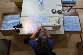 GM Recycles 2 Million Flint Water Bottles into Fleece Image