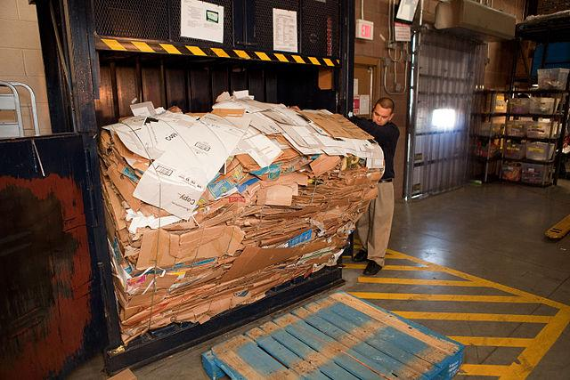640px-Removing_box_bale_from_machine_in_Walmart_back_room.jpg