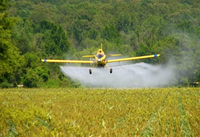 A-crop-duster-spraying-a-field-in-Mississippi.jpg
