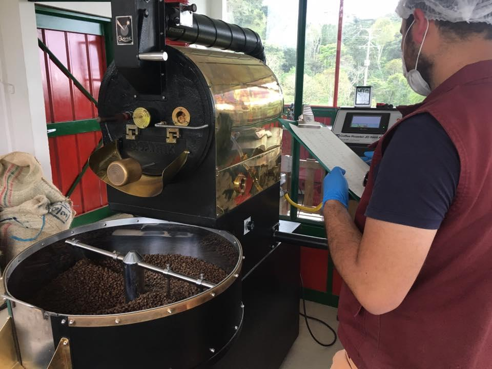 A-worker-checks-the-progress-of-beans-being-roasted-at-a-hacienda-just-outside-Salento-Colombia.jpg