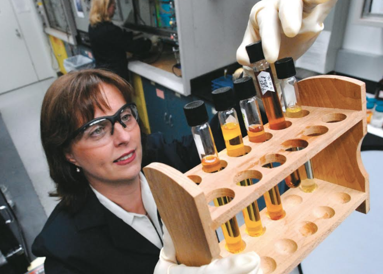 Debbie-Mielewski-a-technical-leader-at-Ford-shows-off-some-potential-bio-based-materials-in-a-lab.png
