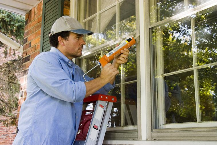 Mancaulkingwindowforenergyefficiency.jpeg