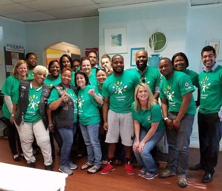 Monica-Lane-middle-row-second-from-the-left-and-her-crew-of-volunteers-at-Nicholas-House-during-the-2017-Comcast-Cares-Day.jpg