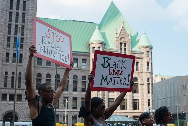 Protesters-at-a-rally-in-response-to-the-George-Zimmerman-verdict-in-Minneapolis-July-2013.jpg