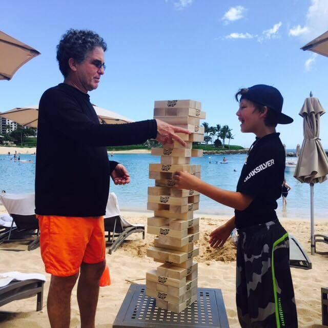 Robert_demonstrating_Giant_Jenga_PokonobeAssociates.jpg