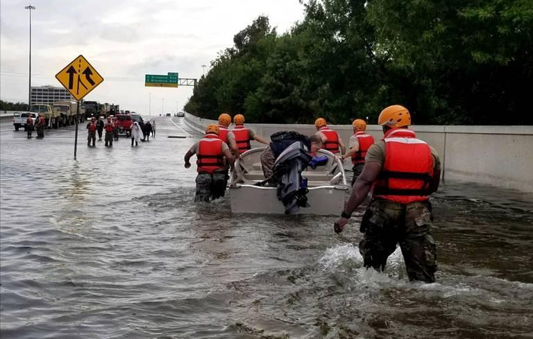 Texas-Army-National-Guard-soldiers-move-through-flooded-Houston-streets-on-August-28.jpg