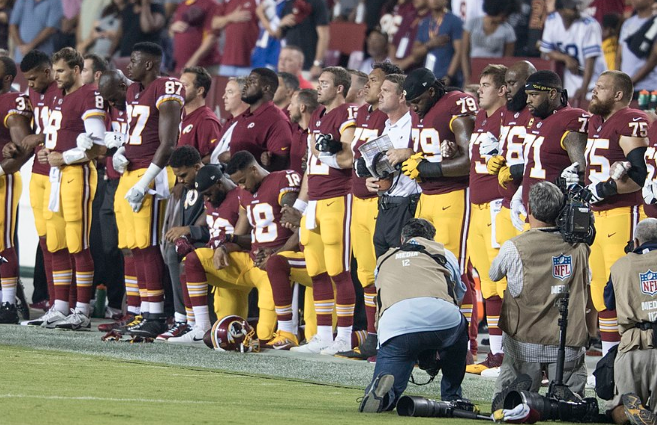 Washington-Redskins-players-kneeling-before-Sunday-nights-game-against-the-Oakland-Raiders.png