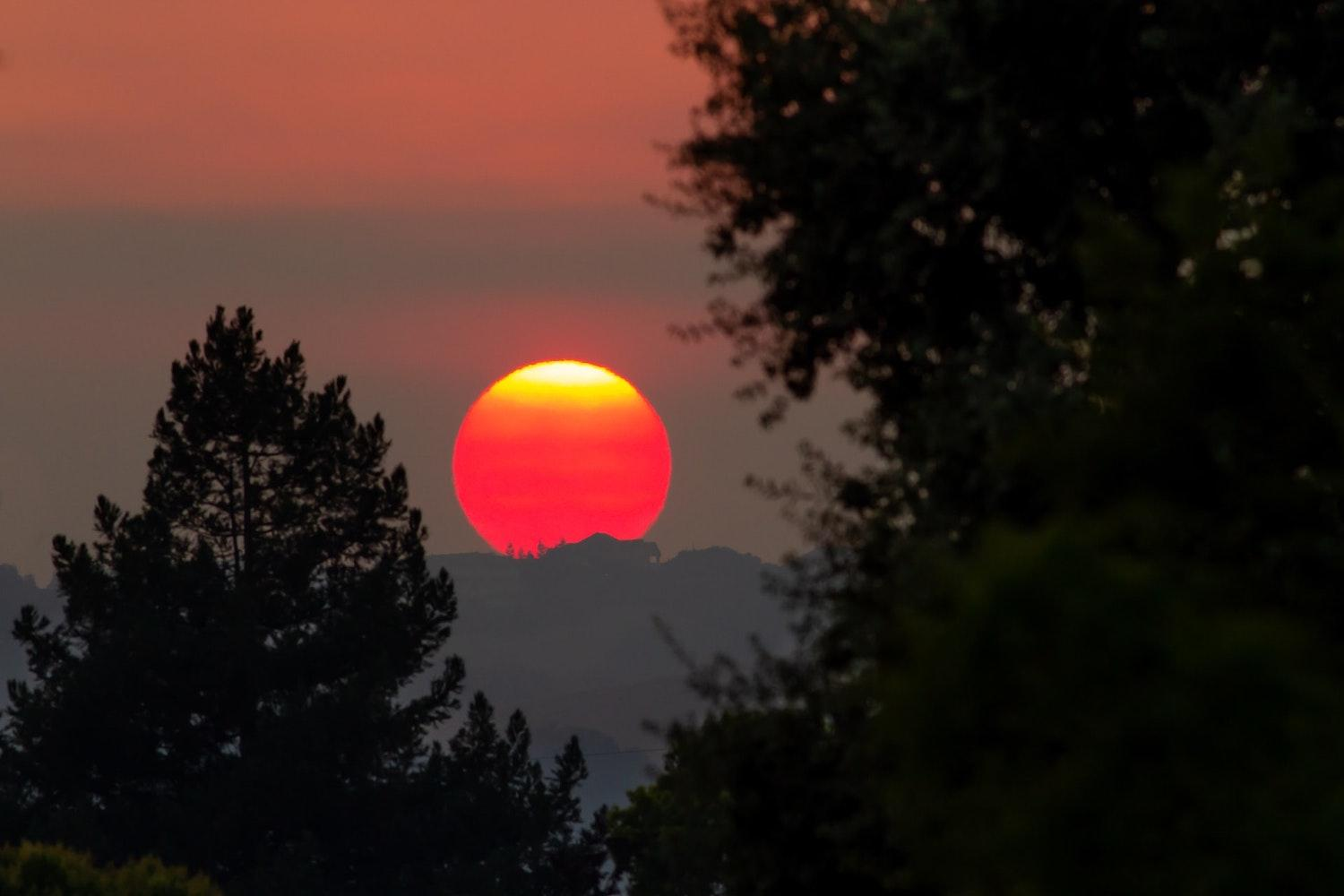 california wildfires glowing sunset climate change ipcc report