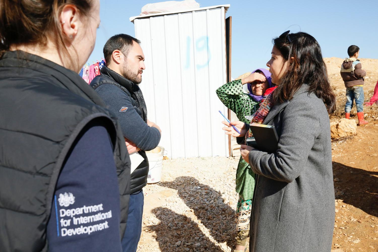 Humanitarian advisers from the U.K's Department for International Development talk to Syrian refugees in the Bekaa Valley, Lebanon, February 2017.
