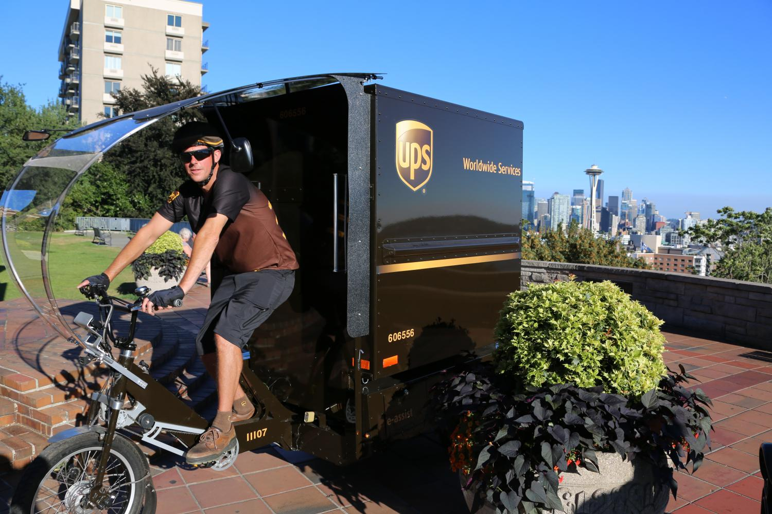 As UPS adds more hybrid and electric vehicles - and even bicycles - as it shifts to a low-carbon fleet, the rattle of the engine you hear as trucks pull up to your house with that coveted package could soon become a thing of the past.